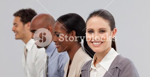 Diverse young business people sitting in a line