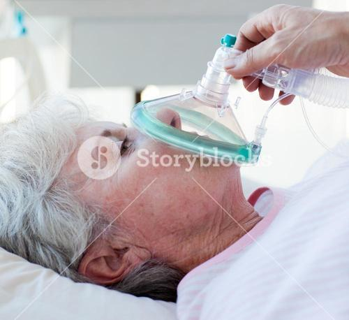 Close up of a female patient receiving oxygen mask