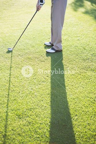 Golfer standing on the putting green