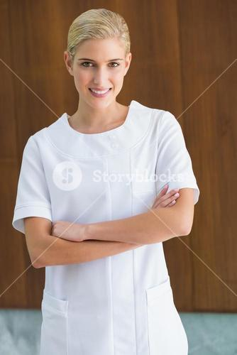 Blonde beauty therapist smiling at camera