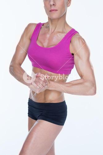 Female bodybuilder flexing in sports bra and shorts