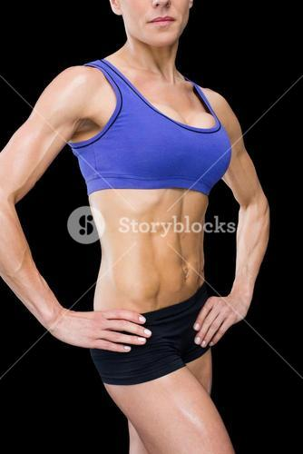 Strong woman posing with hands on hips