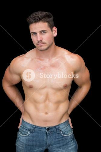 Muscular man posing in blue jeans