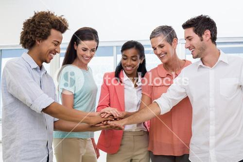 Casual business team putting hands together