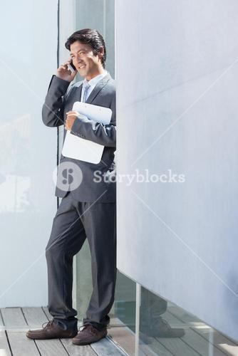 Estate agent talking on phone