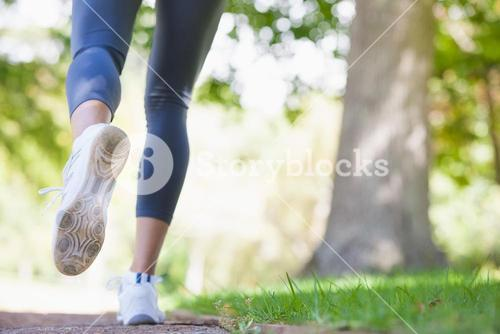 Woman jogging on path in the park
