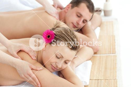 Relaxing couple having a massage
