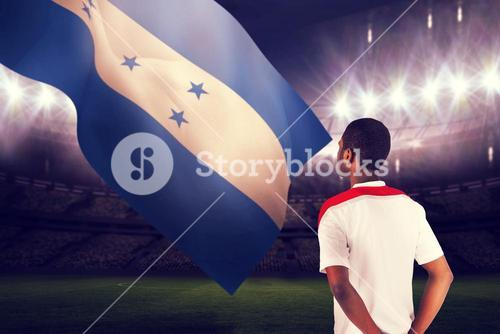 Composite image of football fan in white standing