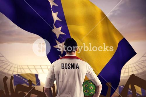 Composite image of bosnia football player holding ball