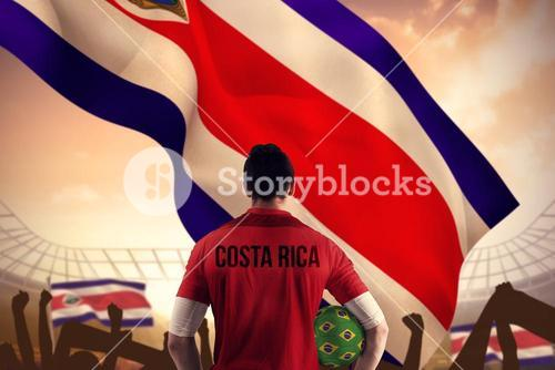 Composite image of costa rica football player holding ball
