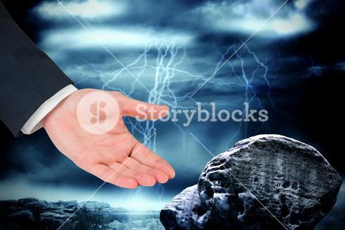 Composite image of businessmans hand presenting
