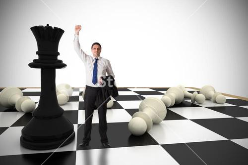 Composite image of businessman cheering
