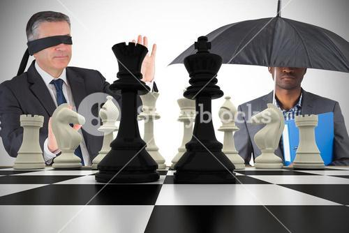 Composite image of businessmen with chessboard