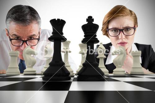 Composite image of business people and chessboard