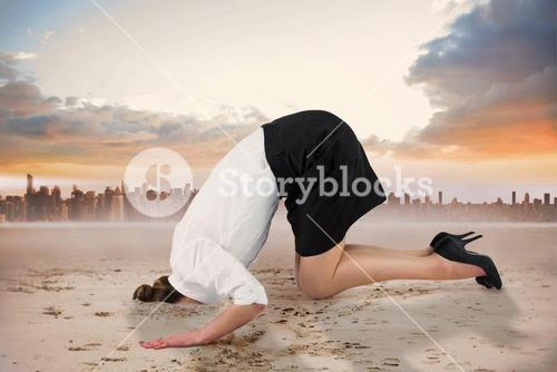 Composite image of businesswoman burying her head