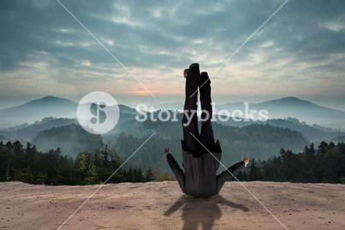 Composite image of businessman burying his head