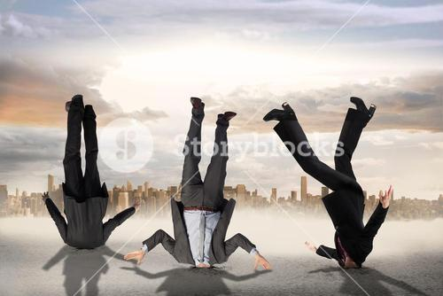 Composite image of business people burying their heads