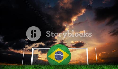 Composite image of football in brasil colours