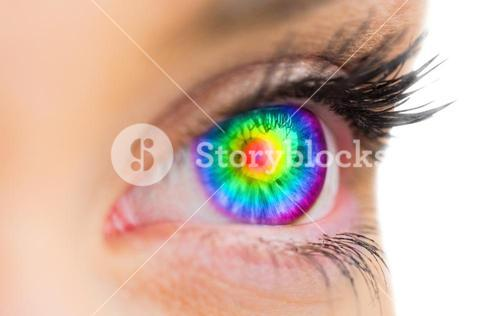 Psychedelic eye looking ahead on female face