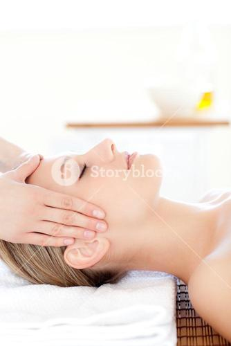 Close up of a young woman receiving a head massage