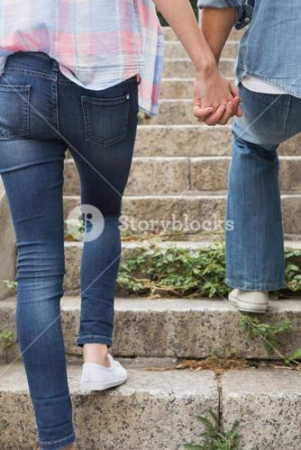 Hip young couple walking up steps