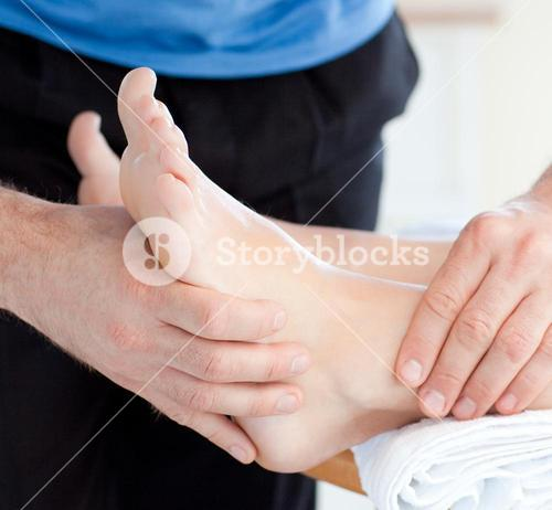 Close up of a woman enjoying a foot massage