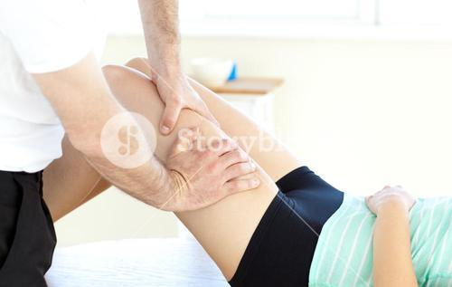 Close up of a woman receiving a leg massage