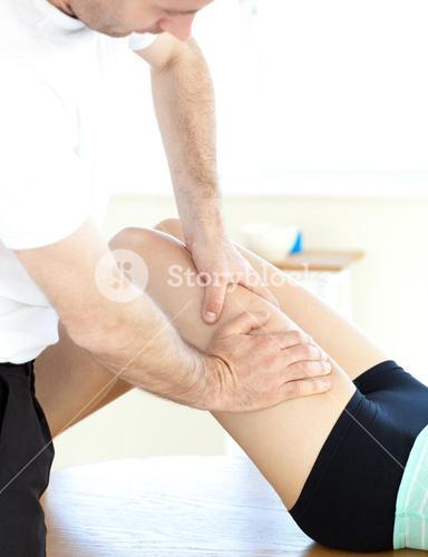 Young woman receiving a leg massage