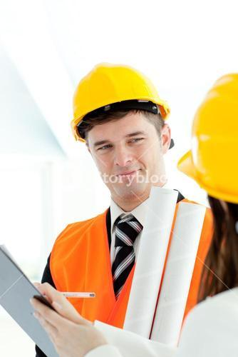 Handsome architect discussing with his colleague
