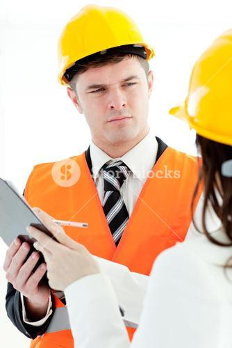Selfassured architect discussing with his colleague
