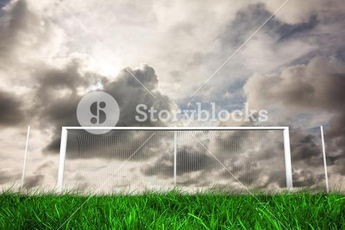 Football goal under grey cloudy sky