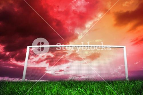 Football goal under red cloudy sky
