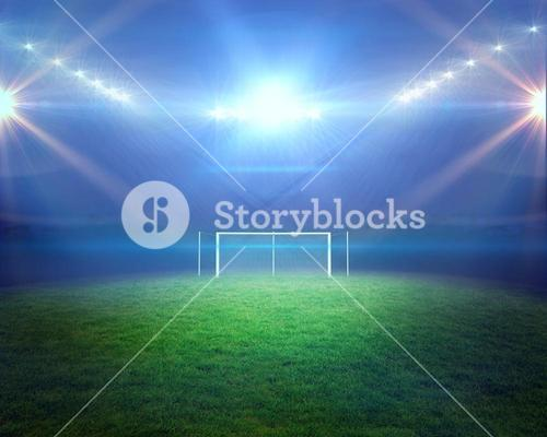 Football pitch with lights and goalpost