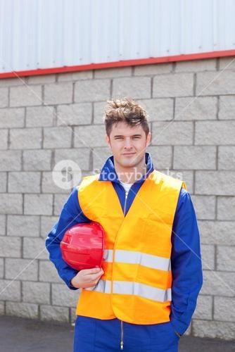 Smiling male engineer standing