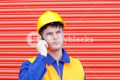 Attractive male engineer talking on the phone