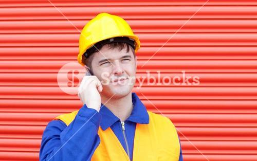 Happy male engineer talking on the phone