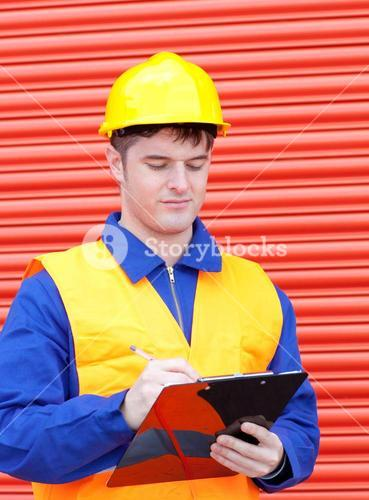 Serious male engineer writing his report