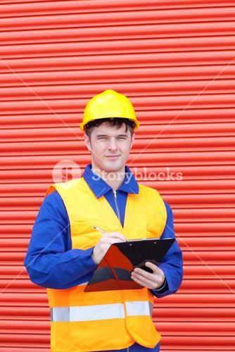 Confident male engineer writing his report
