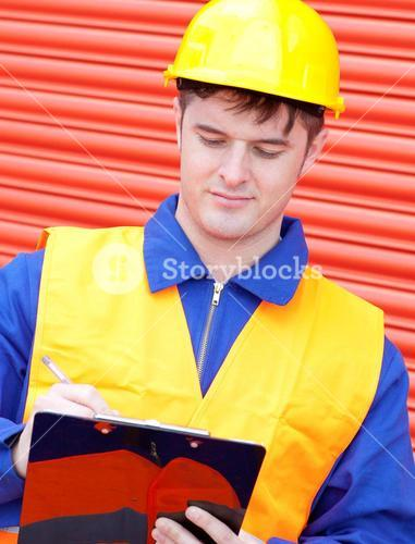 Mature male engineer writing his report