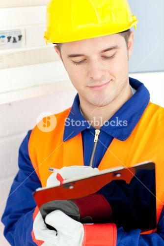 Confident electrician repairing a power plan