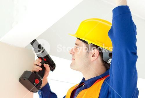 Busy electrician repairing a power plan