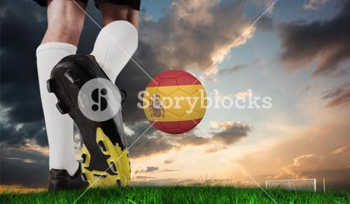 Composite image of football boot kicking spain ball