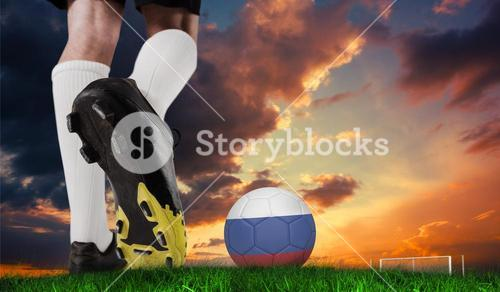 Composite image of football boot kicking russia ball
