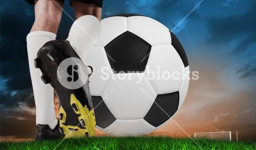 Composite image of football boot kicking huge ball