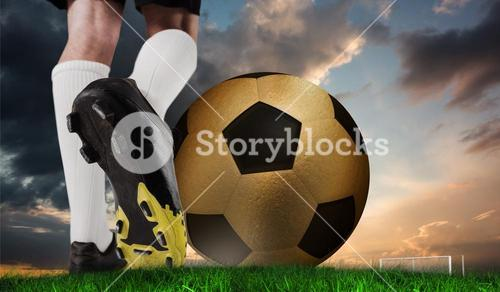 Composite image of football boot kicking huge gold ball