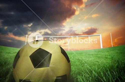 Composite image of gold football