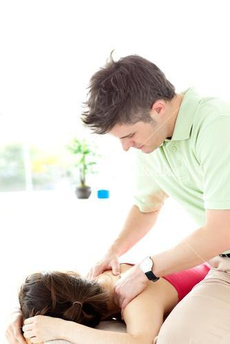 Young man giving a back massage