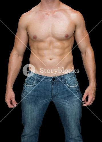 Muscular man posing shirtless in blue jeans