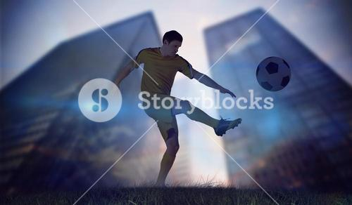 Composite image of football player in yellow kicking