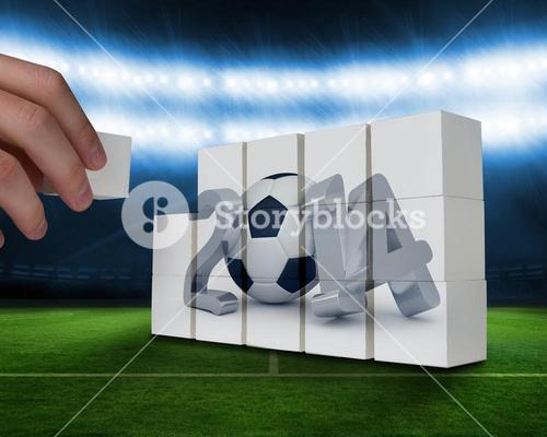 Composite image of hand building wall